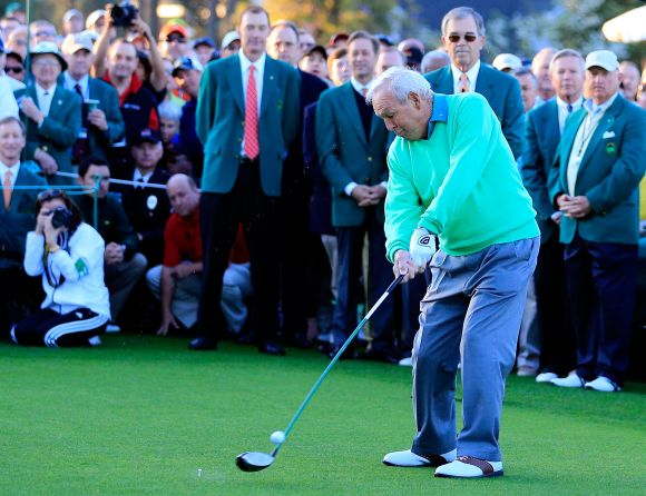 Honorary starter Arnold Palmer hits a tee shot on the first hole at the start of the first round of the 2014 Masters Tournament