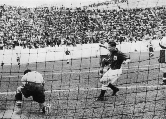 American goalkeeper Frank Borghi saves in front of Tom Finney during the England-USA match