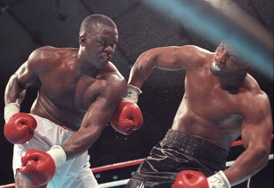 Challenger James Buster Douglas knocks out Mike Tyson in their heavyweight title fight