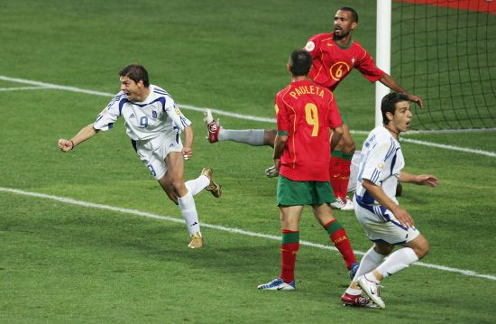 Angelos Charisteas of Greece celebrates scoring their first goal