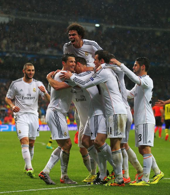 Real Madrid players celebrate after scoring