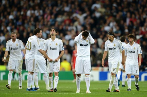 Real Madrid players dejected after losing their sem-final game to Bayern Munich in 2012