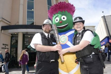 In this handout image provided by Glasgow 2014 Ltd, mascot Clyde poses with PC Louise Seed (left) and Sergeant Steven Lapsley and the Commonwealth Games Baton