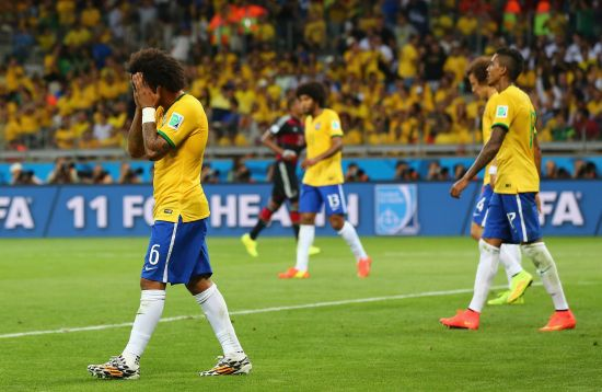 A dejected Marcelo of Brazil reacts after Germany's seventh goal