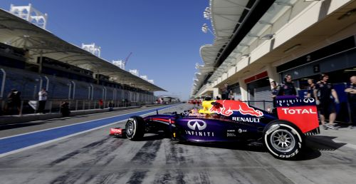 Sebastian Vettel of Germany and Infiniti Red Bull Racing exits his garage to drive