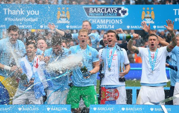 Joe Hart of Manchester City celebrates with his team-mates at the end of the Barclays Premier Lea