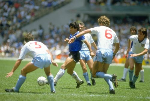 Diego Maradona dribbles on way to his second goal during the 1986 World Cup match against England