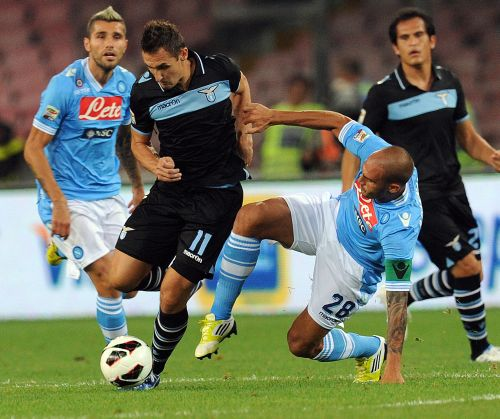 Miroslav Klose of Lazio and Paolo Cannavaro of Napoli in action during the Serie A match