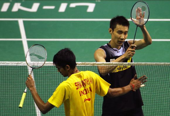 Malaysia's Lee Chong Wei (R) celebrates after defeating India's K. Srikanth