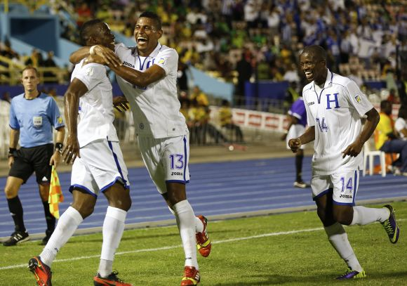 Honduras' Maynor Figueroa (L) celebrates with teammates Carlos Costly (C) and Garcia Oscar after scoring