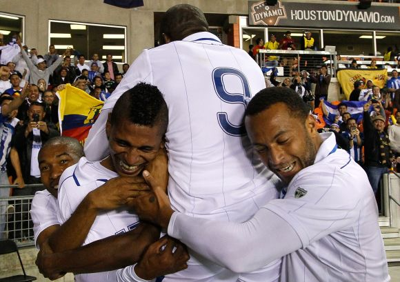 Carlo Costly #13 of Honduras reacts after scoring his second goal against Ecuador with Wilson Palacios #8, Maynor Figueroa #3, Jerry Palacios #9