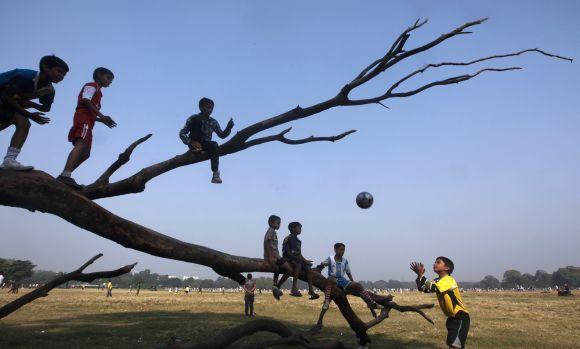 Kids play football in Kolkata