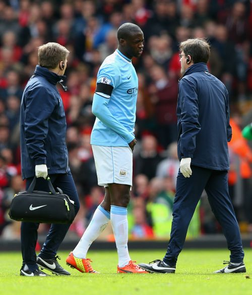 Yaya Toure of Manchester City goes off injured during the Barclays Premier League match between Liverpool and Manchester City