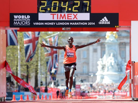 Wilson Kipsang of Kenya crosses the finish line to win the men's elite race at the Virgin London Marathon