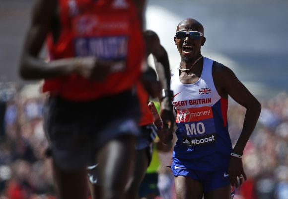 Mo Farah of Britain sprints down The Mall before finishing in eighth position
