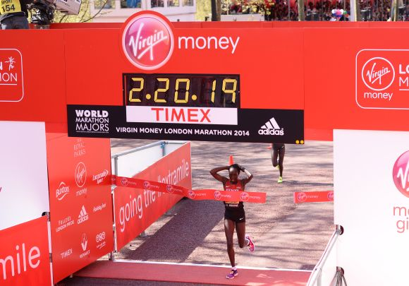 Edna Kiplagat crosses the finish line to win the women's elite race at the Virgin London Marathon