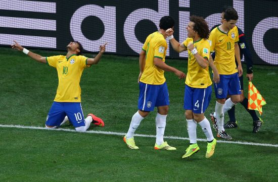 Neymar of Brazil (left) celebrates after scoring with teammates during the 2014 FIFA World Cup Brazil Group A match against Croatia at Arena de Sao Paulo