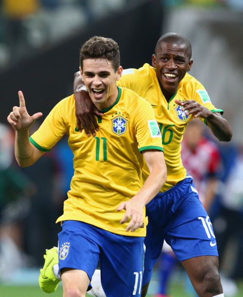 Oscar (left) celebrates his goal with Ramires.