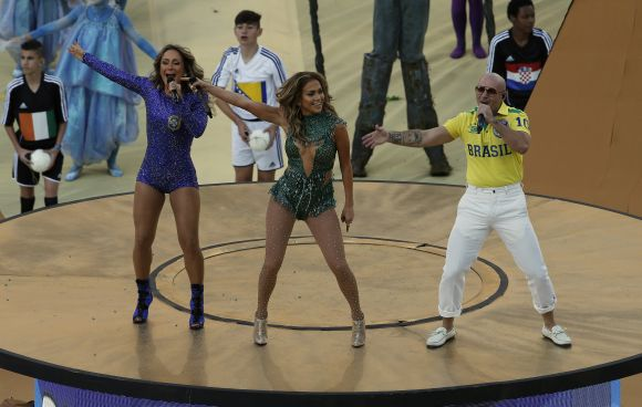 Singers Claudia Leitte (L), Jennifer Lopez (C) and Pitbull perform during the 2014 World Cup opening ceremony at the Corinthians arena in Sao Paulo