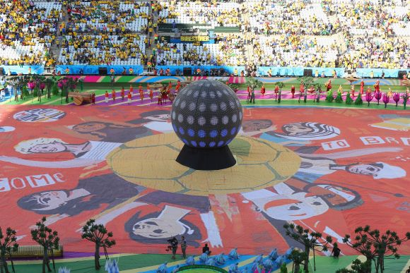 The Happiness Flag is seen as artists perform during the Opening Ceremony of the 2014 FIFA World Cup Brazil