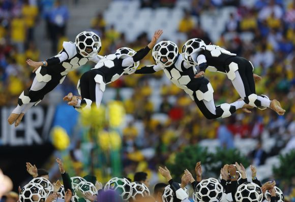 Performers are thrown into the air during the 2014 World Cup opening ceremony.