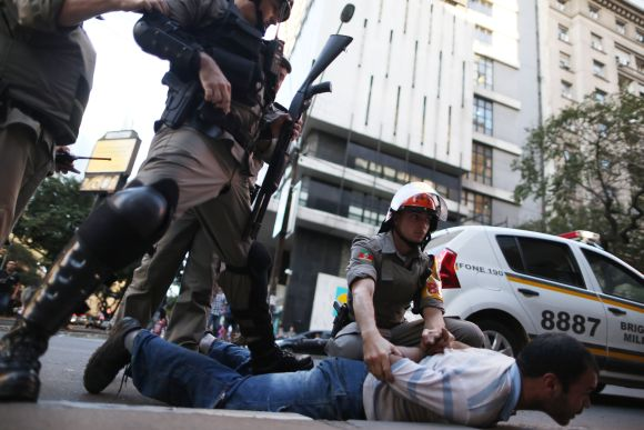 A demonstrator is detained after clashes with police during a protest against the 2014 World Cup in Porto Alegre