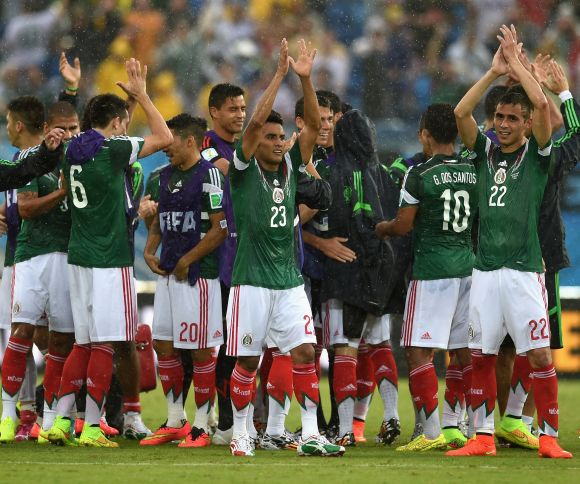 Mexican players celebrate after winning the game