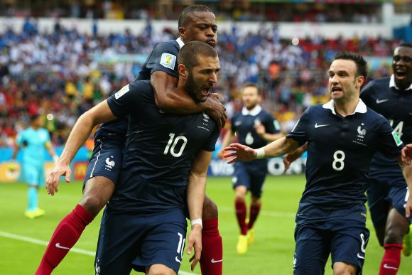Karim Benzema of France celebrates scoring the first goal with Patrice Evra, Mathieu Valbuena against Honduras