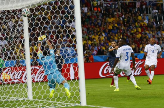 France's Karim Benzema scores past goalkeeper Noel Valladares of Honduras
