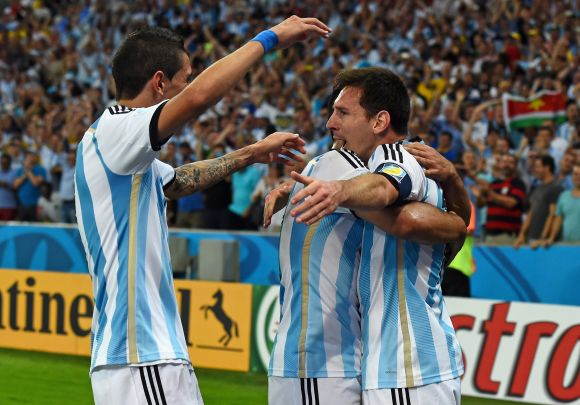 Lionel Messi of Argentina (right) celebrates scoring his team's second goal with teammates