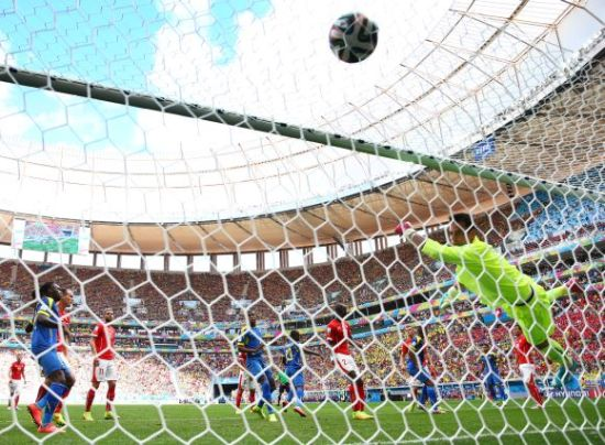 Enner Valencia of Ecuador (centre) puts his team ahead with a header past Diego Benaglio of Switzerland