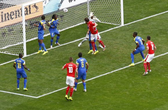 Switzerland's Admir Mehmedi (centre, in red) heads to score against Ecuador