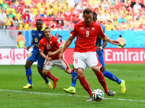 Haris Seferovic of Switzerland shoots and scores his team's second goal
