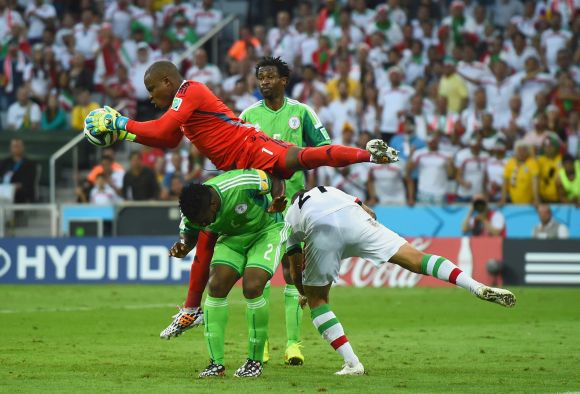 incent Enyeama of Nigeria makes a save over teammates Joseph Yobo and Ashkan Dejagah of Iran
