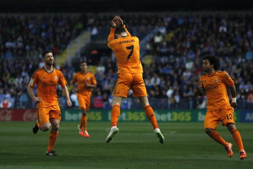 Real Madrid's Cristiano Ronaldo (C) celebrates after scoring a goal against Malaga