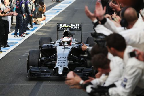 Kevin Magnussen of Denmark and McLaren celebrates as he drives into parc ferme after finishing third during the Australian Formula One Grand Prix