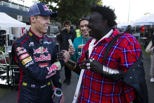 Daniil Kvyat of Russia and Scuderia Toro Rosso is congratulated after finishing tenth