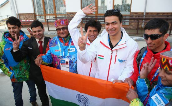 Indian athletes Shiva Keshavan and Himanshu Thakur pose for a photo during the welcome ceremony and flag raising at the mountain athletes village