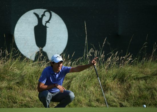 Matteo Manassero of Italy lines up on the 3rd green during the first round of The 143rd Open Championship