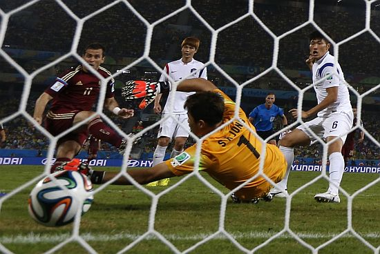 Russia's Alexander Kerzhakov scores a goal against South Korea during their 2014 World Cup