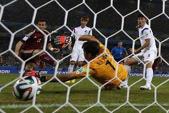 Russia's Alexander Kerzhakov scores a goal against South Korea