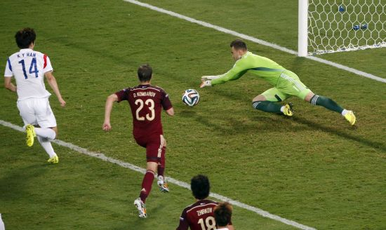 Russia's goalkeeper Igor Akinfeev makes a save