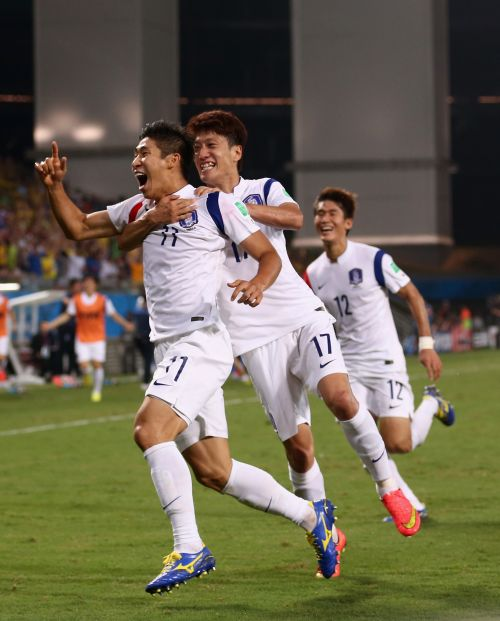 Lee Keun-Ho of South Korea (L) celebrates scoring his team's first goal