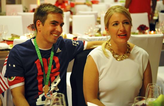 Bayern Munich's Philipp Lahm and his wife Claudia attend the team's after-match party