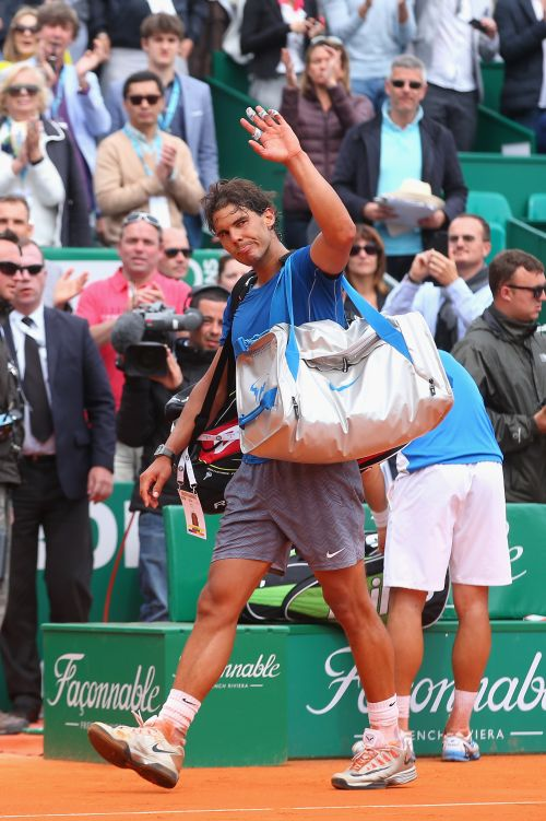 Rafael Nadal of Spain walks off court after losing in his match against David Ferrer