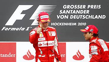 Fernando Alonso (left) and Felipe Massa on the podium after the German GP on Sunday
