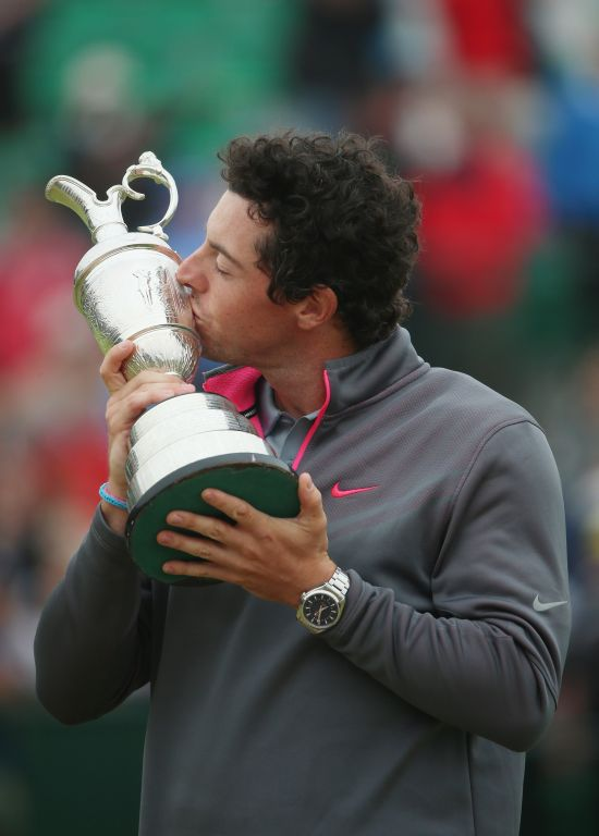 Rory McIlroy of Northern Ireland kisses the Claret Jug after his two-stroke victory at The 143rd Open Championship at Royal Liverpool