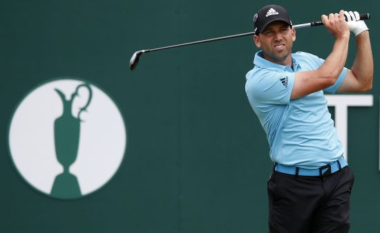 Sergio Garcia of Spain watches his tee shot on the first hole