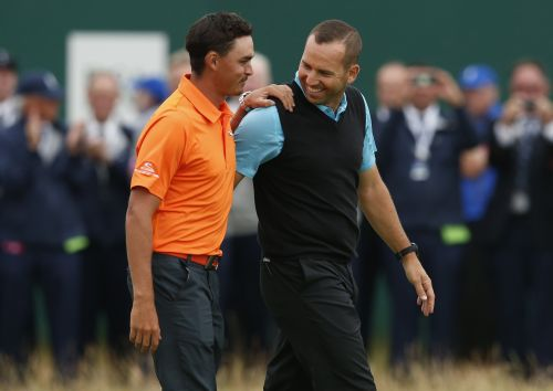 Rickie Fowler of the U.S. (L) walks with Sergio Garcia of Spain on the 18th green after they finished as joint runners-up in the British Open Championship
