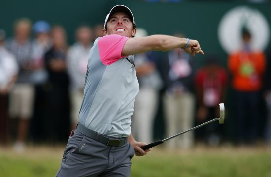 Rory McIlroy of Northern Ireland celebrates on the 18th green after winning the British Open Championship